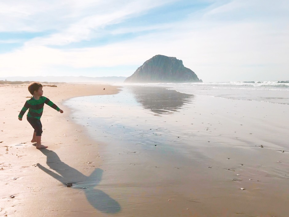 The world's cutest toddler, running along a beach