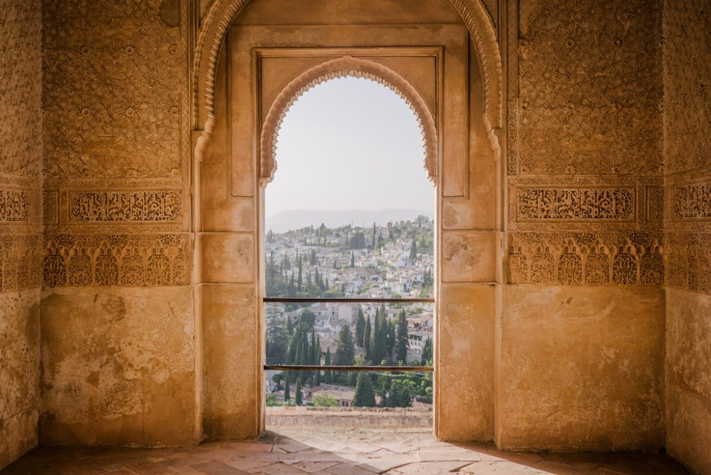 A peek out of a golden window at the Alhambra in Granada, Spain.